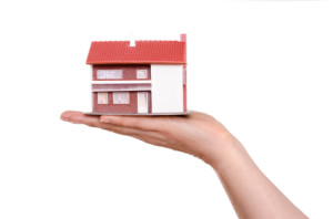 Residence house on a female hand